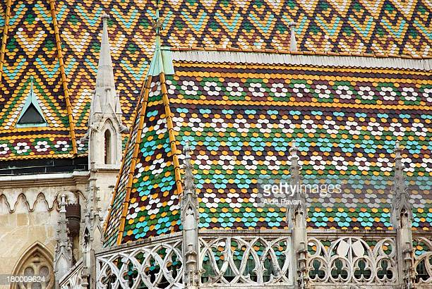 the colored tiles of the roof - budapest stock-fotos und bilder