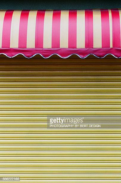 The colorful canopy and yellow store