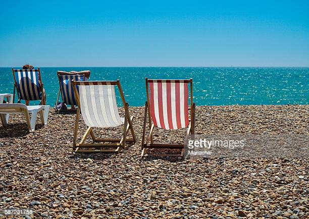 the colorful deck chairs on Brighton beach, UK