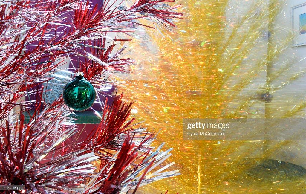 Colorful aluminium Christmas trees decorate the Denver home of Monica Martinez and husband John Huggins. : News Photo