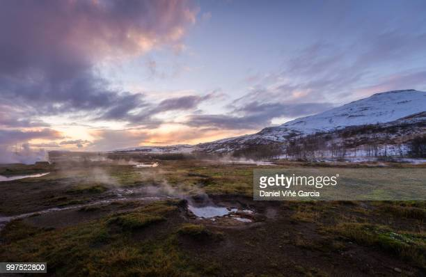 The colorful geyser landscape at the Haukadalur geothermal area, part of the golden circle route,...