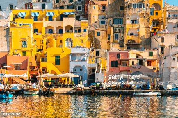 the colorful houses in la corricella district, procida island, italy - naples italie photos et images de collection