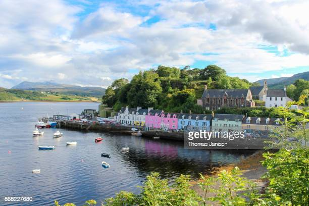 The colorful houses of the Portree Harbor