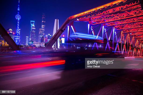 The colorful shanghai at night with taxi in motion