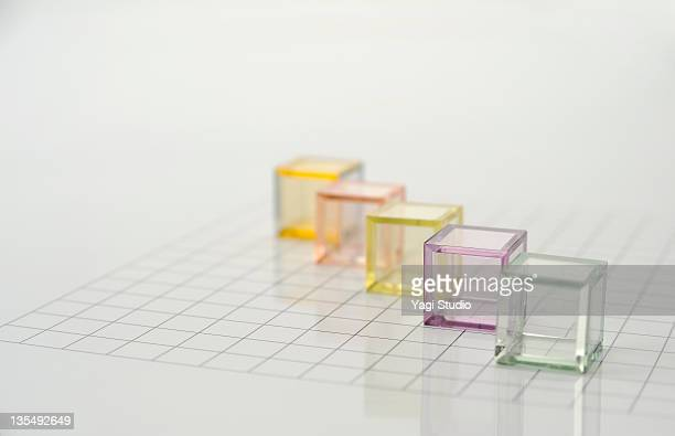 The colorful translucent cubes are arranged