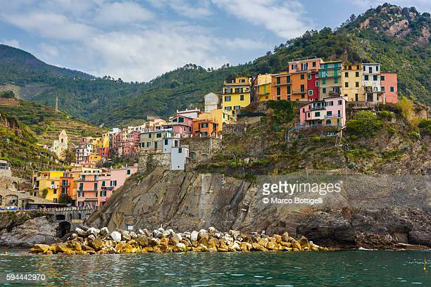 The colorful village of Manarola seen from a boat.