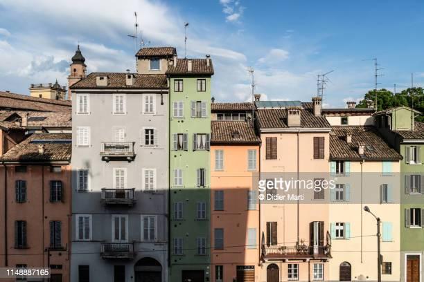 the colorfull facade of houses in parma - cultura italiana fotografías e imágenes de stock