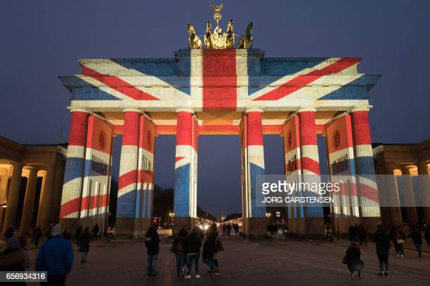 TOPSHOT The colors of British flag are seen on Brandenburg Gate on March 23 2017 in Berlin the day after the March 22 terror attack in London / AFP...