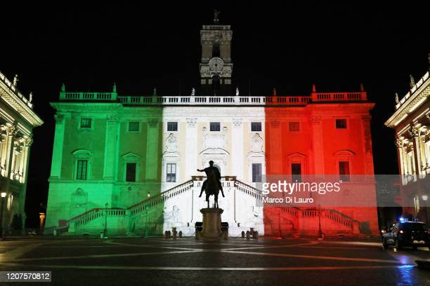 The colors of the Italian flag are projected onto the Palazzo Senatorio building on Capitoline Hill in the historic city center as a van of the...