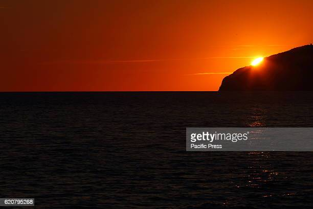 The colors of the sun when comes over the horizon of the sea near the Monte Argentario in Maremma