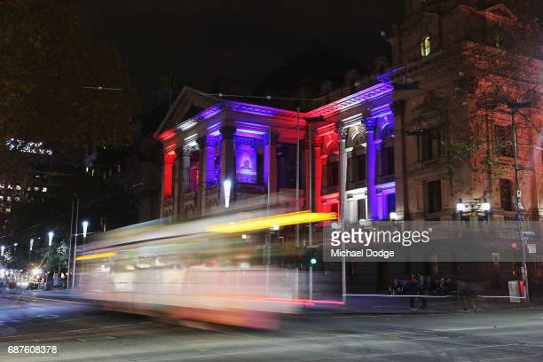 The colors of the Union Jack the national flag of the United Kingdom are projected on to the Melbourne Town Hall as a tribute to Manchester Bombing...