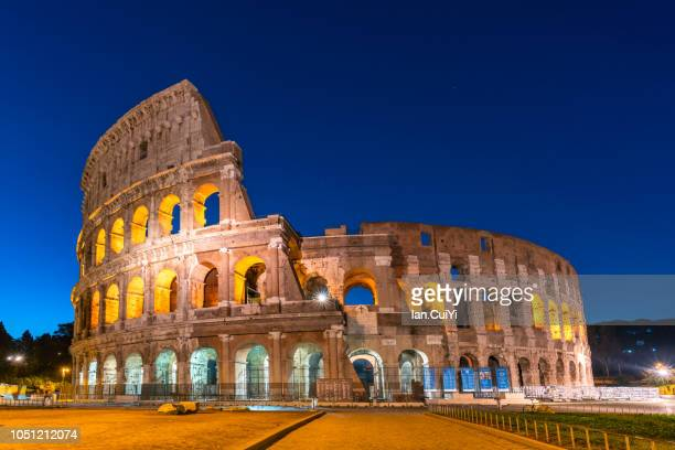 the colosseum at the blue hour (dusk) - colosseum stock pictures, royalty-free photos & images