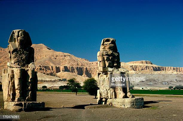 The Colossi of Memnon These two statues are all that is left of the mortuary temple of Amenophis III on the West Bank of the Nile at Luxor Egypt
