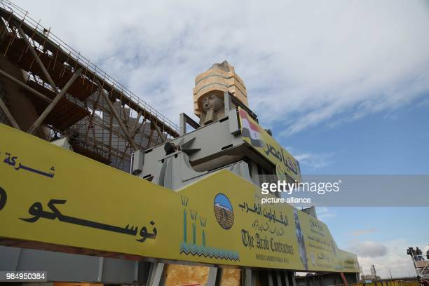 The colossus of Pharaoh King Ramses II is loaded onto a truck to be transferred to it's permanent display spot at the Grand Egyptian Museum in Giza...