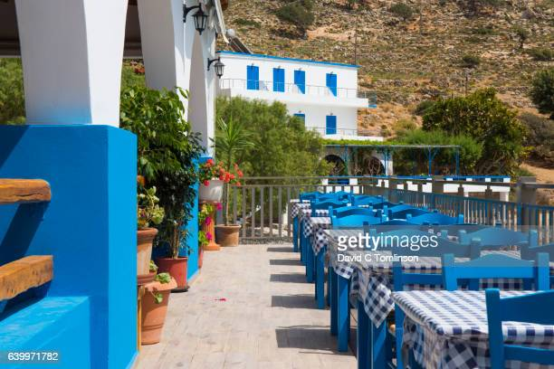 The colourful seafront terrace of a typical taverna, Loutro, Crete, Greece