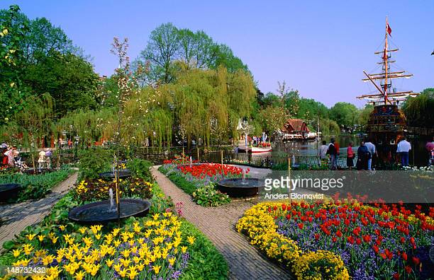 The colourful spring floral display at Tivoli Gardens with the pirate ship St Georg behind.