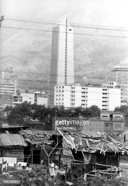 The Coltejer building a newly built skyscraper rises behind shacks Medellin Colombia 1970s