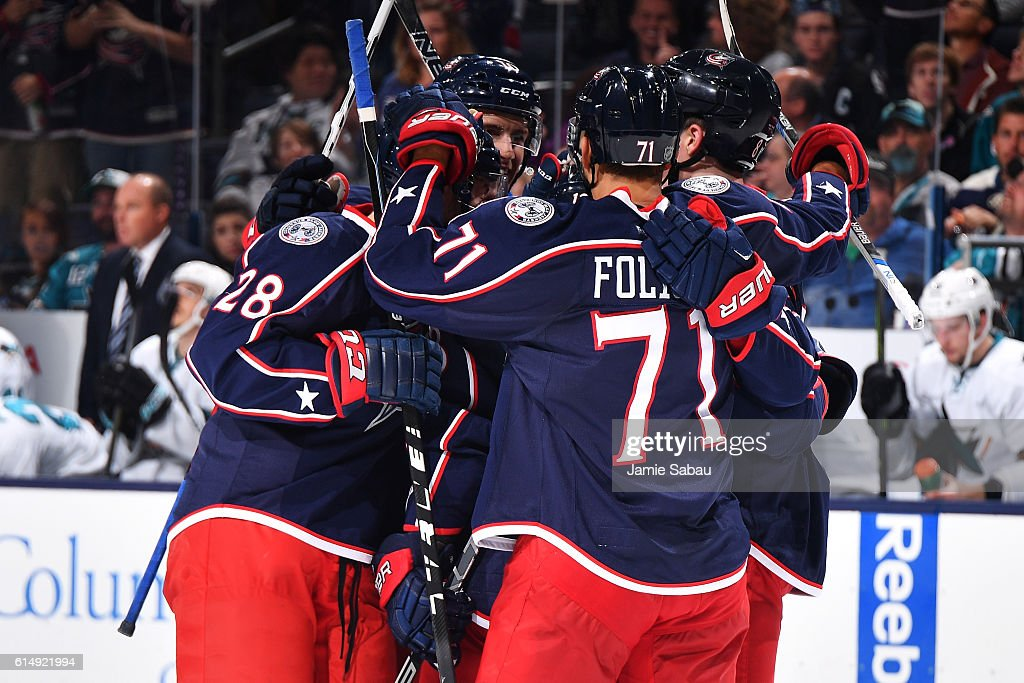 The Columbus Blue Jackets celebrate a third period goal during a game against the San Jose Sharks on October 15, 2016 at Nationwide Arena in Columbus, Ohio. San Jose defeated Columbus 3-2.
