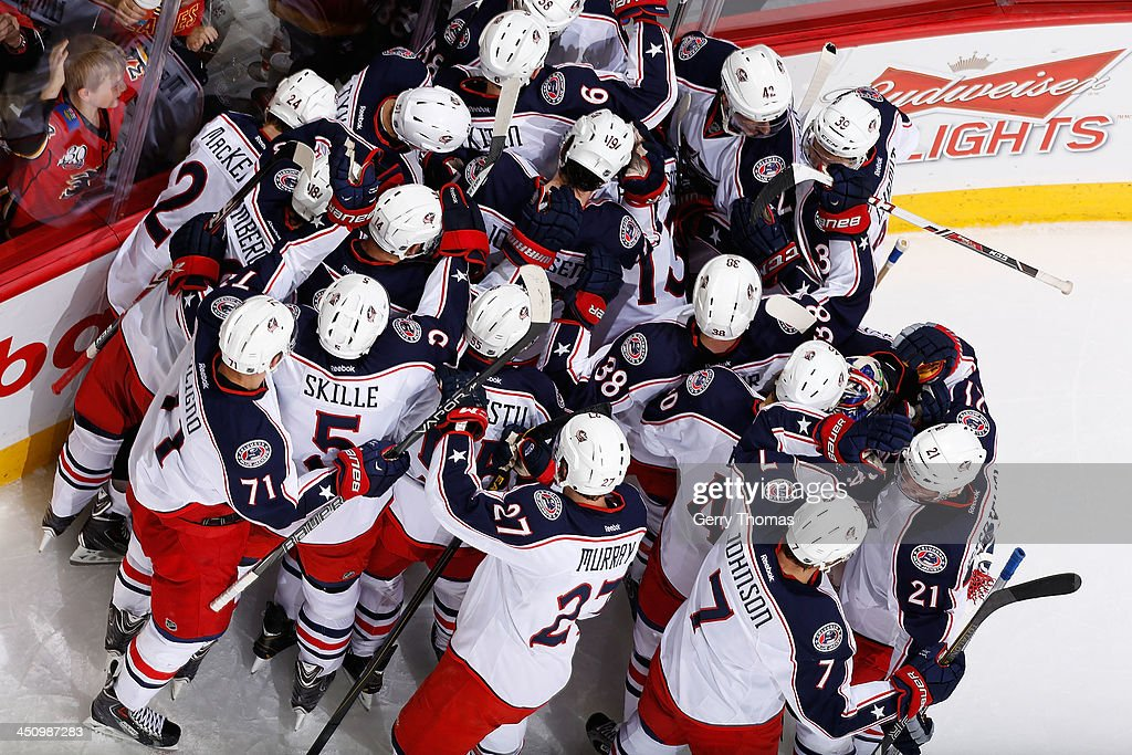 The Columbus Blue Jackets celebrate a win against the Calgary Flames at Scotiabank Saddledome on November 20, 2013 in Calgary, Alberta, Canada.