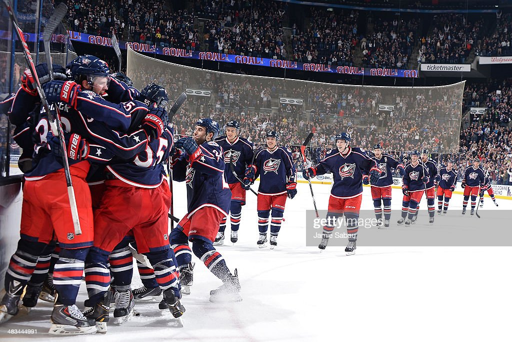 The Columbus Blue Jackets celebrate after defeating the Phoenix Coyotes 4-3 in overtime on April 8, 2014 at Nationwide Arena in Columbus, Ohio.