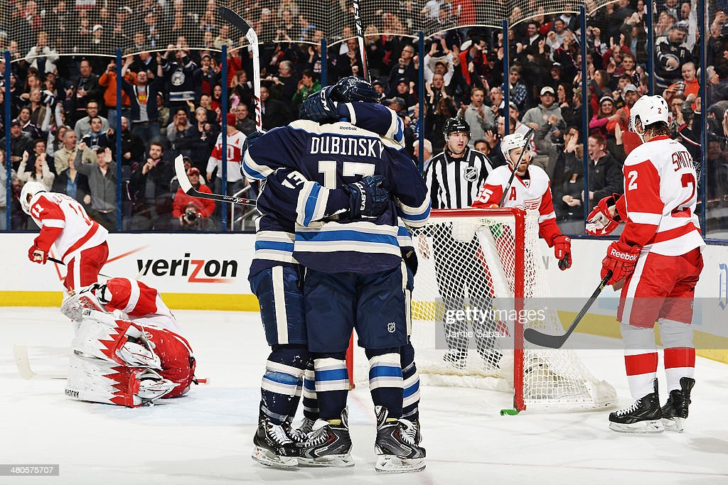 The Columbus Blue Jackets celebrate after scoring the game-winning goal against the Detroit Red Wings during the third period on March 25, 2014 at Nationwide Arena in Columbus, Ohio. Columbus defeated Detroit 4-2.