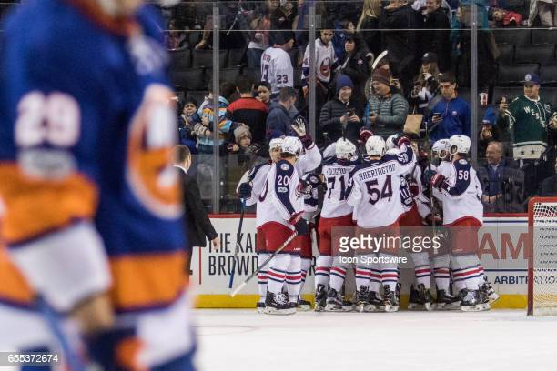 The Columbus Blue Jackets celebrate as the NY Islanders clear the ice after Columbus Blue Jackets Right Wing Cam Atkinson scores in overtime in a...