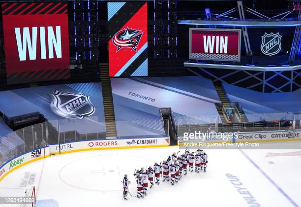 The Columbus Blue Jackets celebrate the 2-0 win over the Toronto Maple Leafs in Game One of the Eastern Conference Qualification Round prior to the...