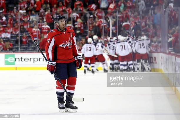The Columbus Blue Jackets celebrate the game winning goal as Brooks Orpik of the Washington Capitals skates off the ice during the Blue Jackets 54...