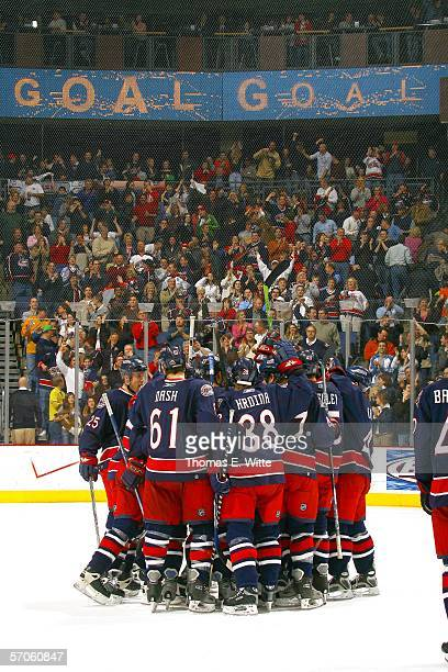 The Columbus Blue Jackets celebrate their sudden death win against the Edmonton Oilers at Nationwide Arena on March 11, 2006 in Columbus, OH....