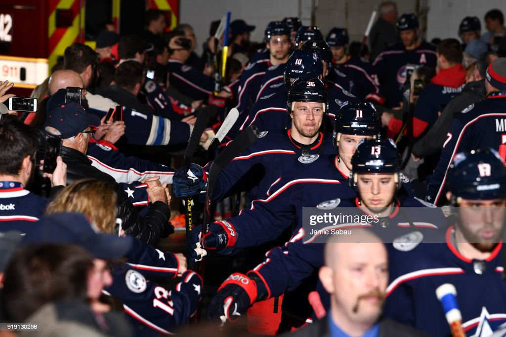 the columbus blue jackets high five fans before taking the ice for a game against