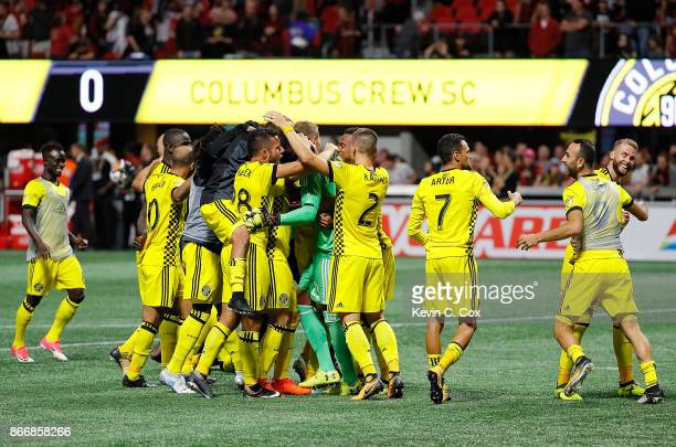 The Columbus Crew celebrates after Adam Jahn converts a penalty kick to give the Crew a win over the Atlanta United 31 on penalties during the...