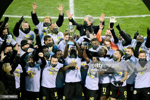 The Columbus Crew celebrates with the Eastern Conference trophy after their 1-0 win over the New England Revolution during the Eastern Conference...