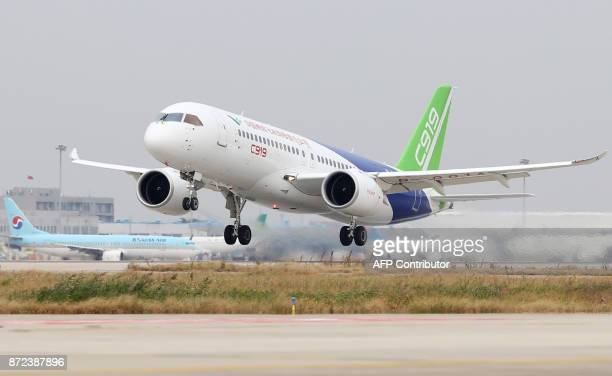 The Comac C919 China's first large passenger jet takes off from Pudong International Airport in Shanghai on November 10 2017 The plane started its...