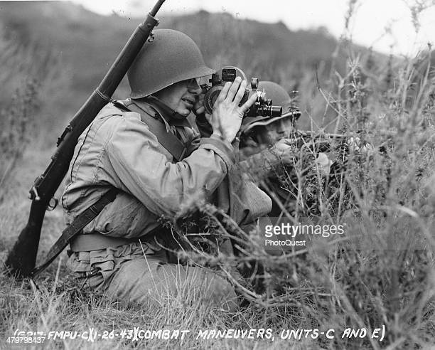 The combat cameraman and his crew carefully photograph every battle scene Culver City California early 1940s Here the cameraman is effectively...