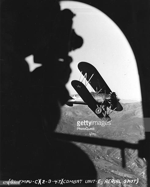 The combat cameraman of the Army Air Forces is at home on the land or in the air early 1940s A member of the First Motion Picture Unit of Culver City...