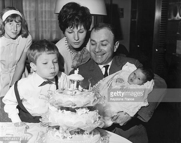 The Comedian And Actor Fernand Reynaud Celebrating The Baptism Of His Daughter Francoise Surrounded By His Wife And His Son Pascal Who Is Blowing Out...
