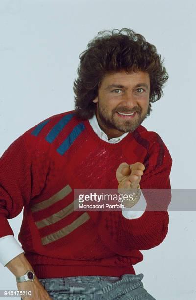 The comedian Beppe Grillo presenting the Tv show Te lo do io il Brasile 1984