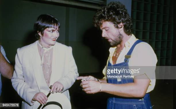 The comedian Beppe Grillo talking to the singer Anna Oxa in the backstage of Vota la Voce 1978