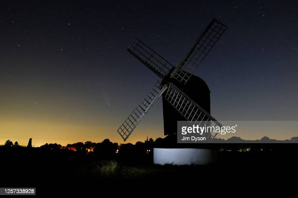 The Comet NEOWISE is seen in the sky behind Pitstone Windmill on July 20 2020 in Ivinghoe United Kingdom The comet is named after NASA's NearEarth...