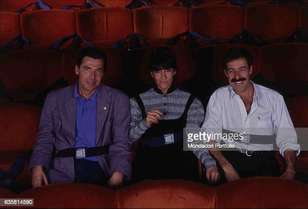 The comic trio formed by Massimo Lopez, Anna Marchesini and Tullio Solenghi posing sitting on the theatre chairs for the theatre show 'Allacciare le...