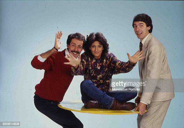 The comic trio formed by Massimo Lopez, Anna Marchesini and Tullio Solenghi posing for a photo shooting. Italy, 1985