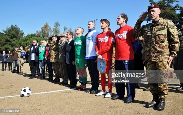 The commander Carmine Masiello former football player Franco Baresi actor Giorgio Pasotti and Italian Minister of Defense Ignazio La Russa attend the...