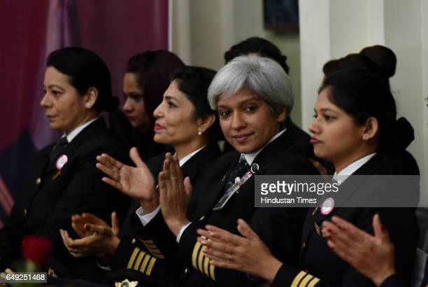 The commander of an all women Air India the country's state owned carrier's Delhi San Francisco Delhi flight Kshamta Bajpai with other pilots cheers...