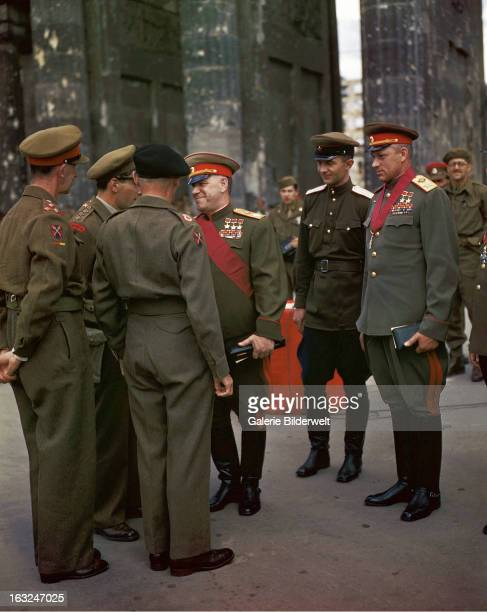 The Commander of the 21st Army Group Field Marshall Sir Bernard Montgomery 2nd from left and the deputy Supreme Commander in Chief of the Red Army...