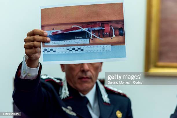 The Commander of the Carabinieri Investigation Team, Colonel Lorenzo D'Aloia shows a printed picture of the knife used in the murder of Carabinieri's...
