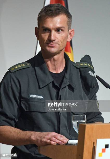 The commander of the GSG 9, Jerome Fuchs, speaks on stage during the ceremony of the elite Police Tactical Unit GSG 9 of the German Federal Police on...