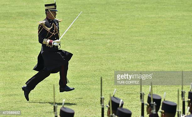 The commander of the Mexican troops in charge of the honour guard runs to take his position during the welcoming ceremony offered by Mexican...