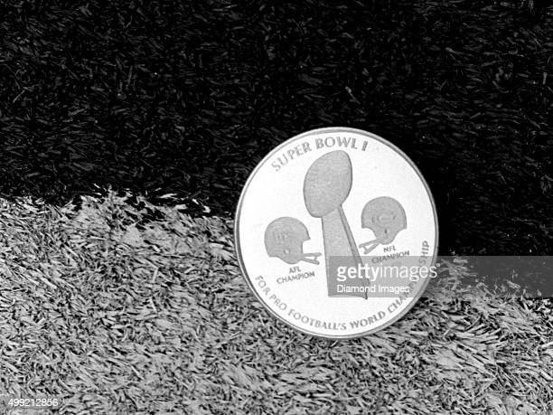 The commemorative coin used for the coin toss at Super Bowl I lies on the field prior to Super Bowl VIII on January 13 1974 between the Miami...