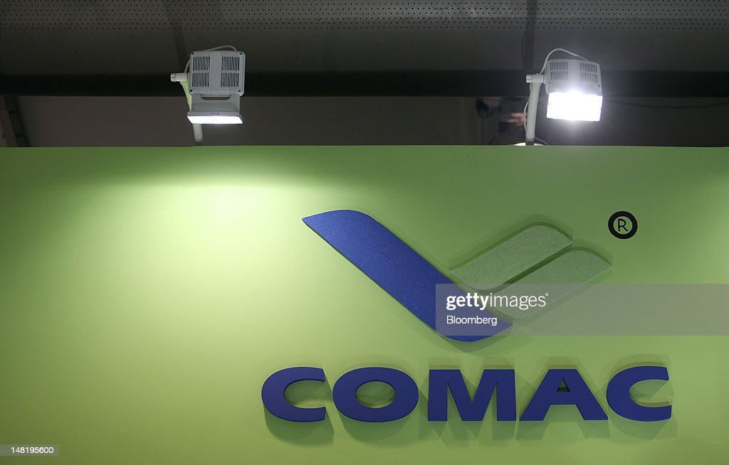 The Commercial Aircraft Corp. of China (Comac) logo sits on a board above the company's stand on the third day of the Farnborough International Air Show in Farnborough, U.K., on Wednesday, July 11, 2012. The Farnborough International Air Show runs from July 9-15. Photographer: Chris Ratcliffe/Bloomberg via Getty Images