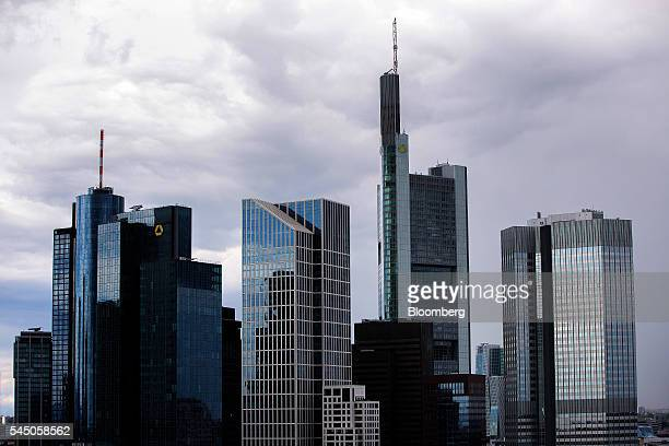 The Commerzbank AG headquarters center stands between other skyscrapers in the financial district in Frankfurt Germany on Sunday July 3 2016 The...